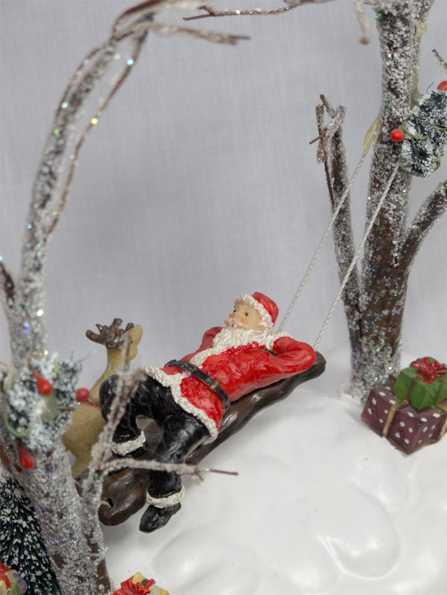Santa Swinging On Bench Between Lit Trees Figurine 20cm